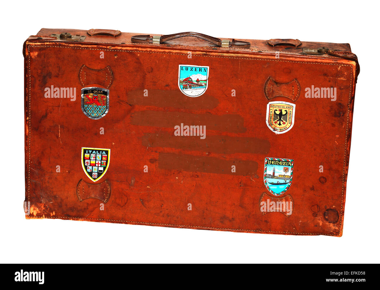 Old leather suitcase with vacation destination stickers on a white background. Please see description - Stock Image