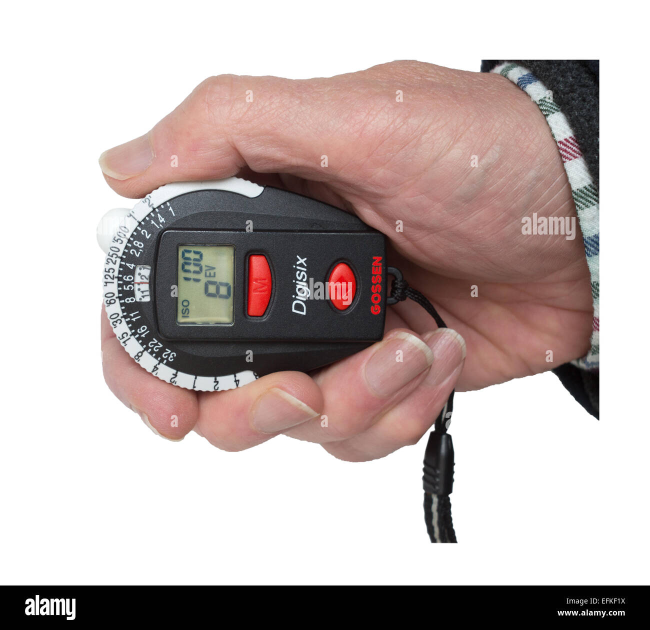 Man's hand holding a Gossen Digisix photographic light or exposure meter isolated on a white background. - Stock Image