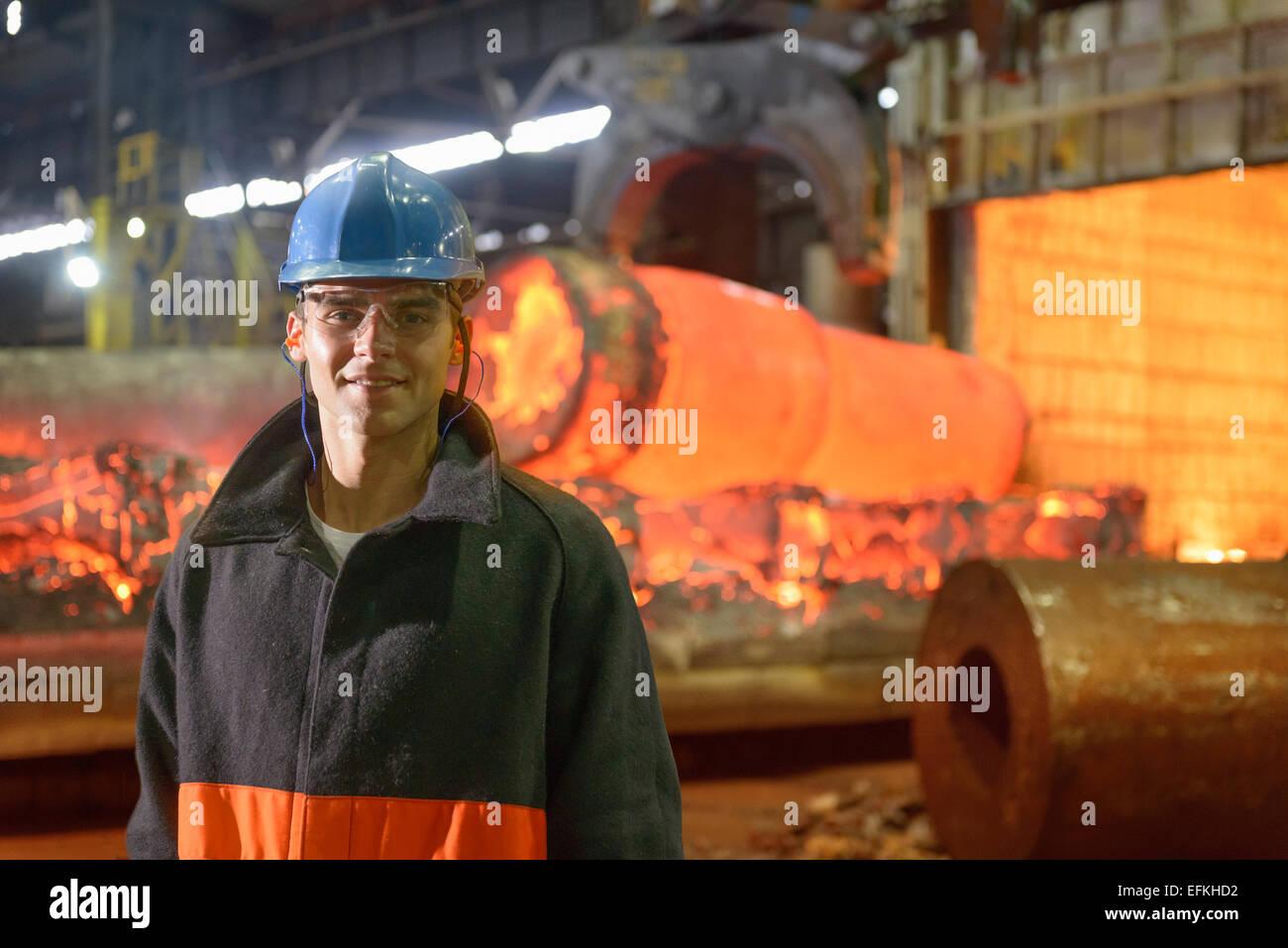 Portrait of steelworker apprentice in steelworks - Stock Image