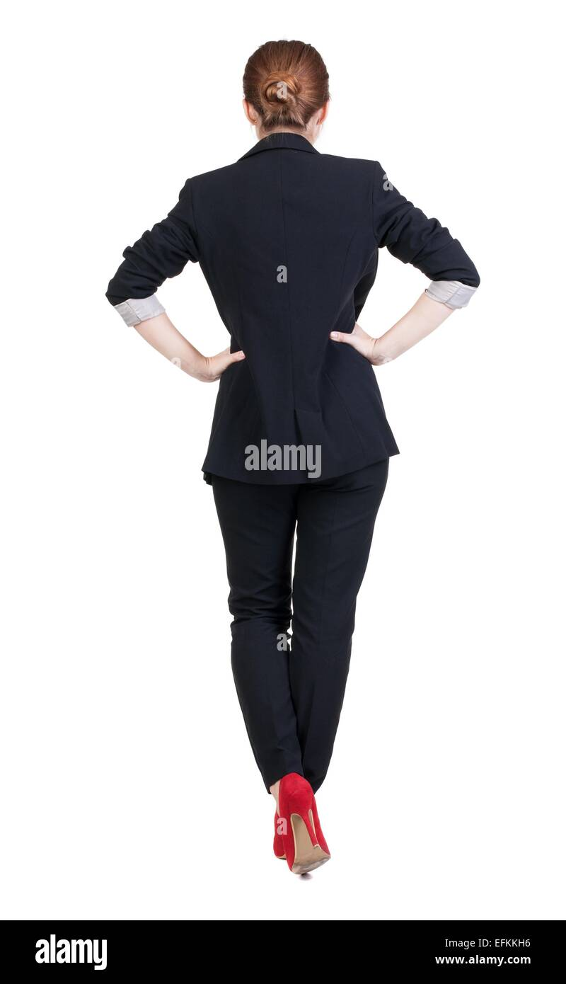 back view of redhead business woman contemplating. Young girl in suit.  Rear view people collection.  backside view - Stock Image
