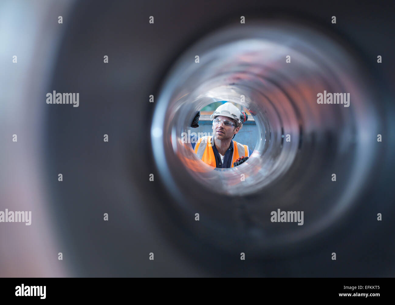 Engineer checking steel part in engineering factory - Stock Image