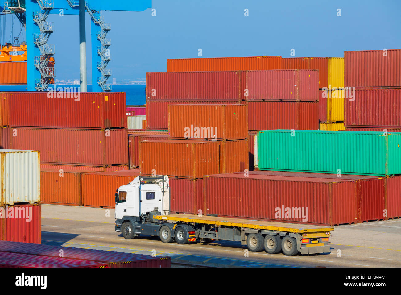 Cargo freight shipping containers at the docks storage area in the