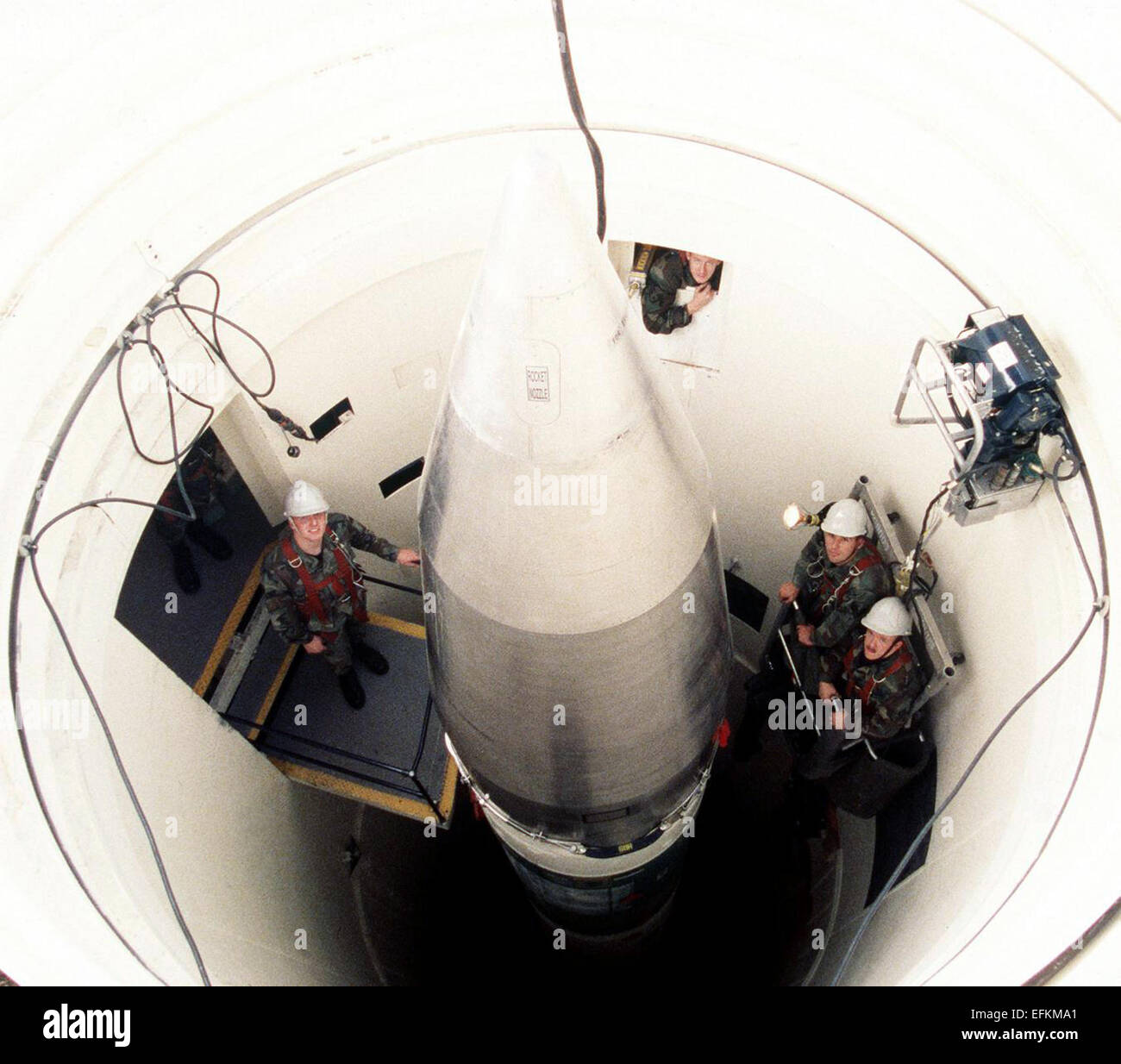 An Air Force Airmen with the 90th Organizational Missile Maintenance Squadron tighten bolts on the upper stage of - Stock Image