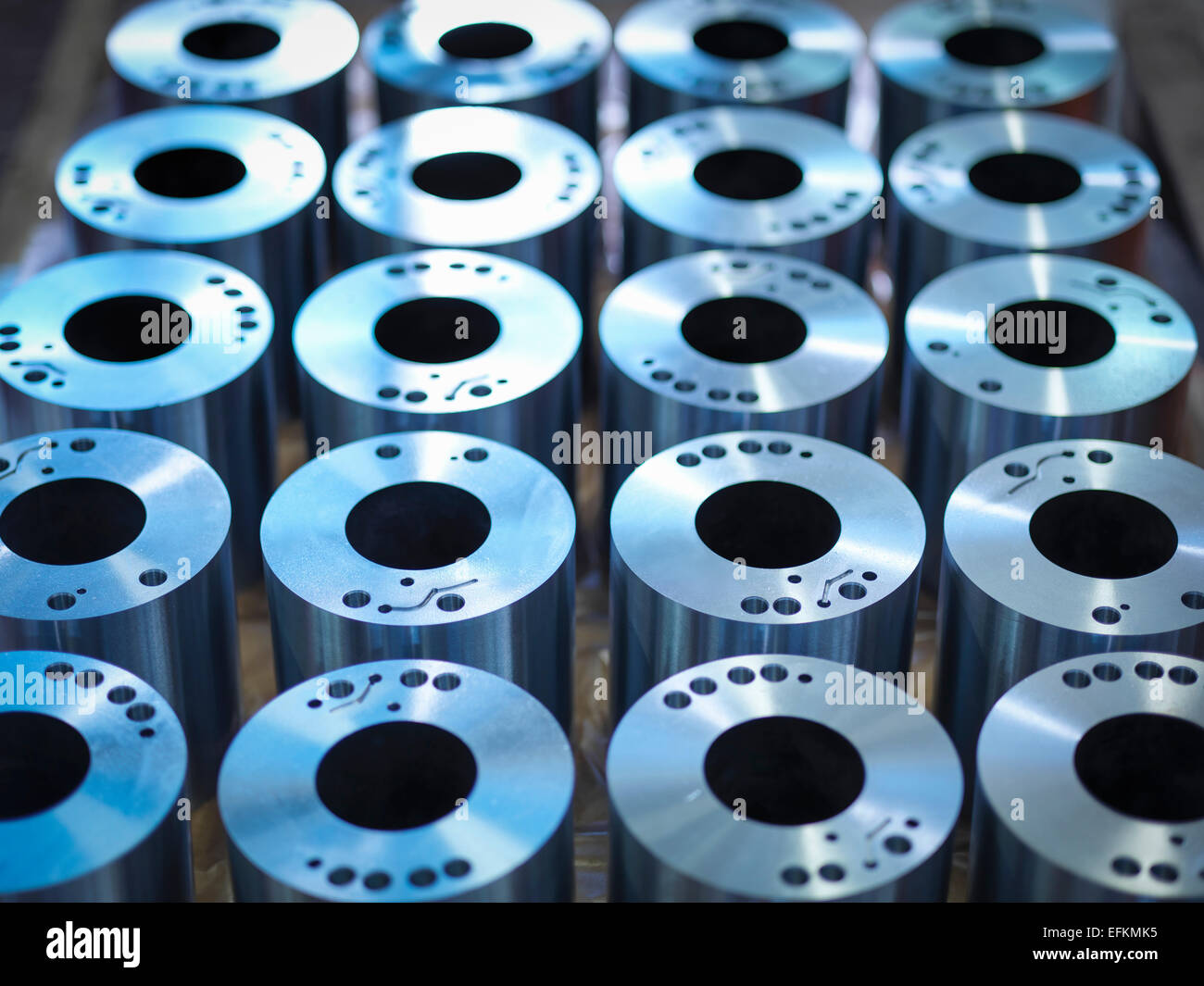 Steel parts on production line in factory - Stock Image