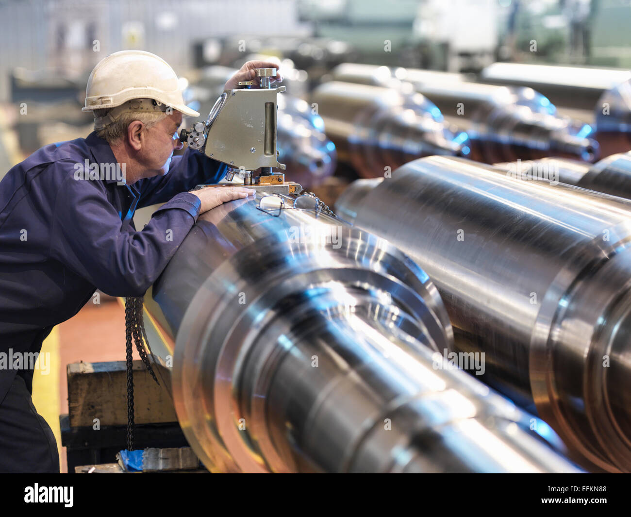 Hardness testing of steel part in engineering factory - Stock Image