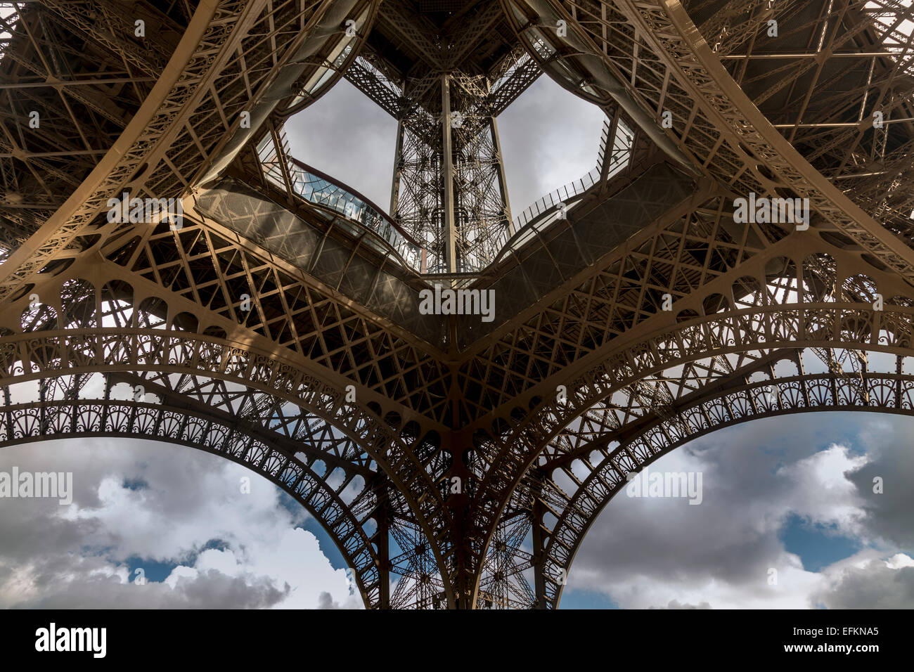 Low angle symmetrical view of Eiffel Tower, Paris, France - Stock Image