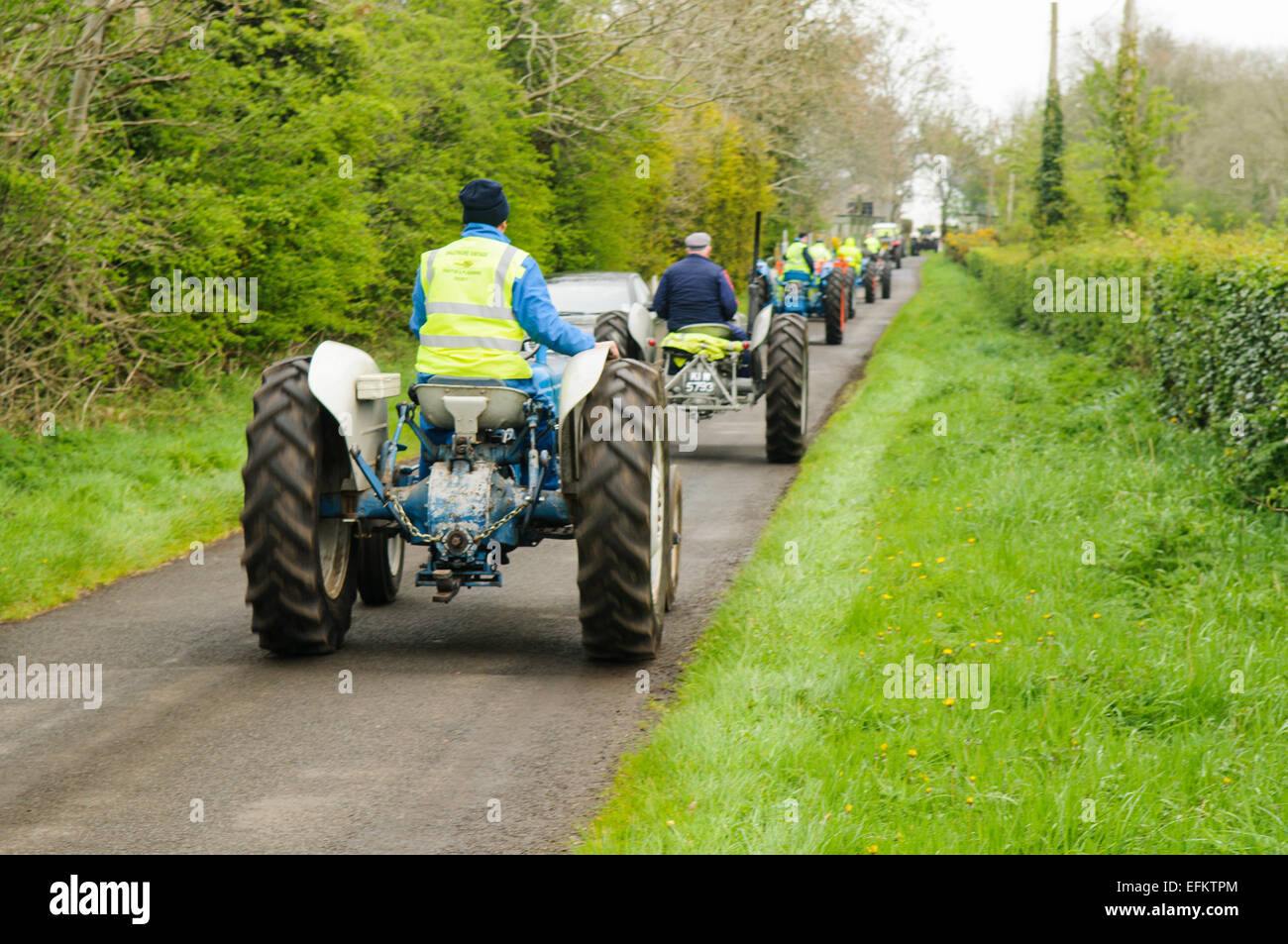 long-line-of-tractors-on-a-country-road-