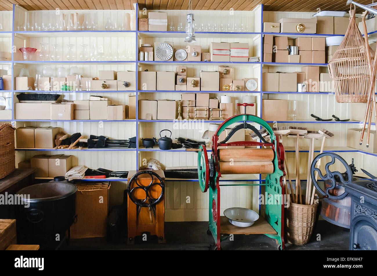 Boxes of household items at an old fashioned Irish hardware store - Stock Image