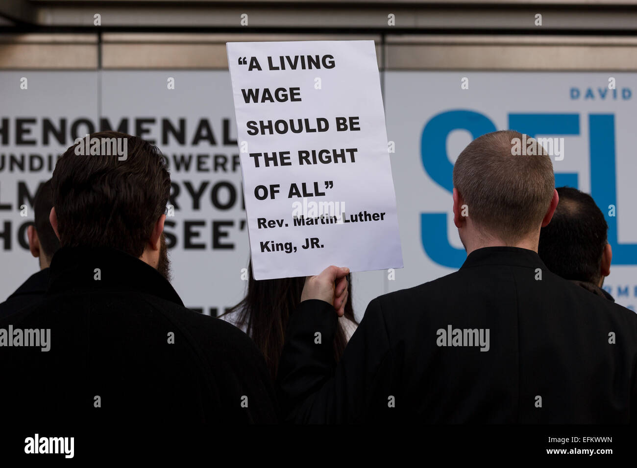 London, UK. 6th February 2015.  Demonstrators stage a protest calling for the living wage to be paid to staff, outside - Stock Image