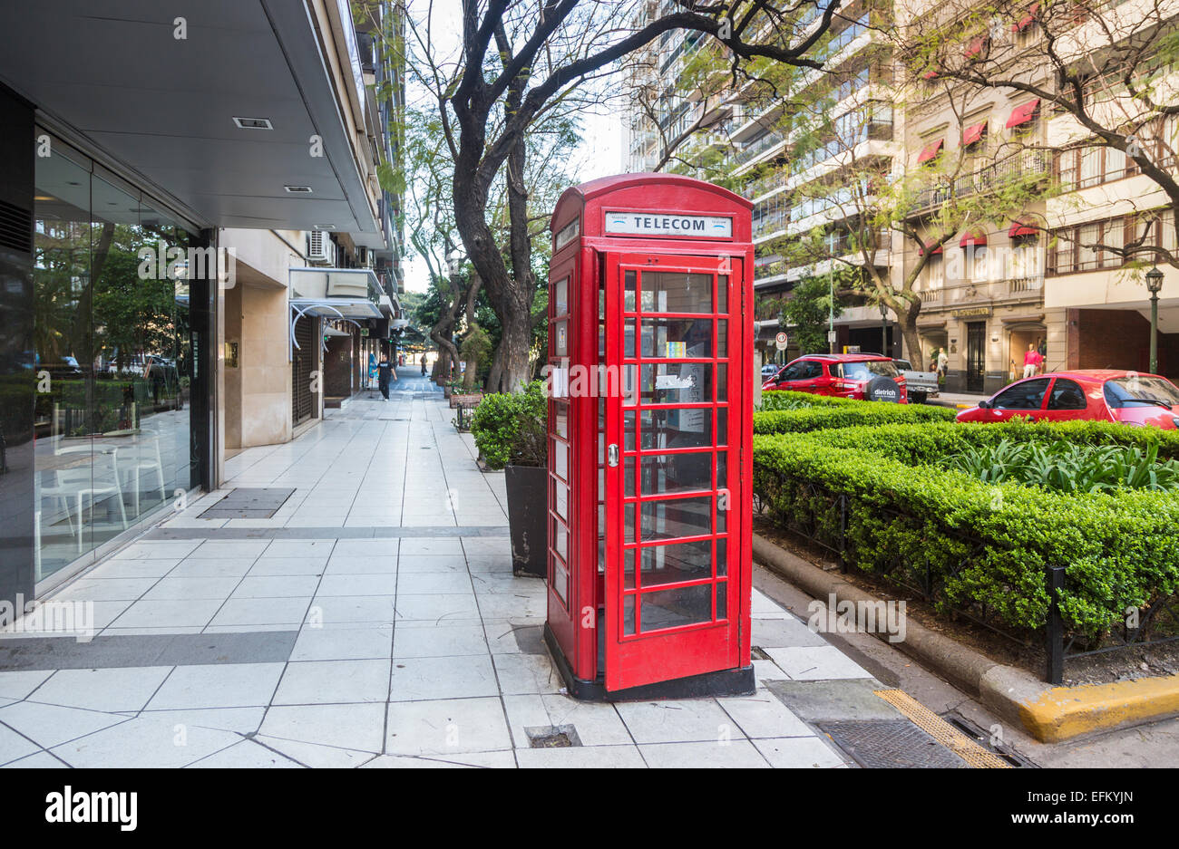 Traditional red British telephone box on the roadside in Recoleta district, downtown Buenos Aires, Argentina - Stock Image