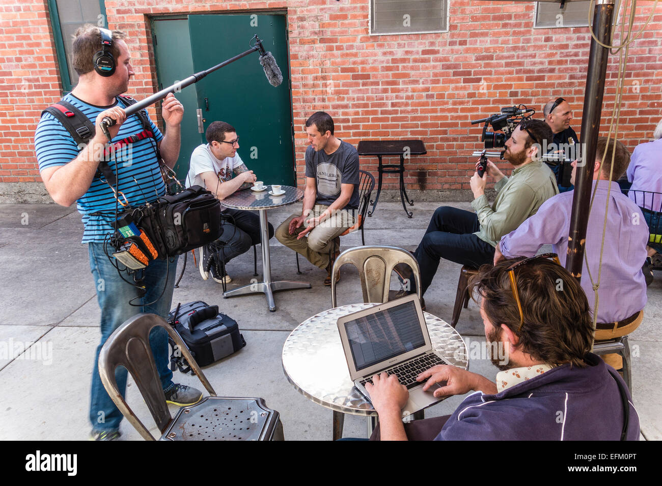 A New York City based independent film production crew film an interview with the owner of the Handlebar coffee - Stock Image