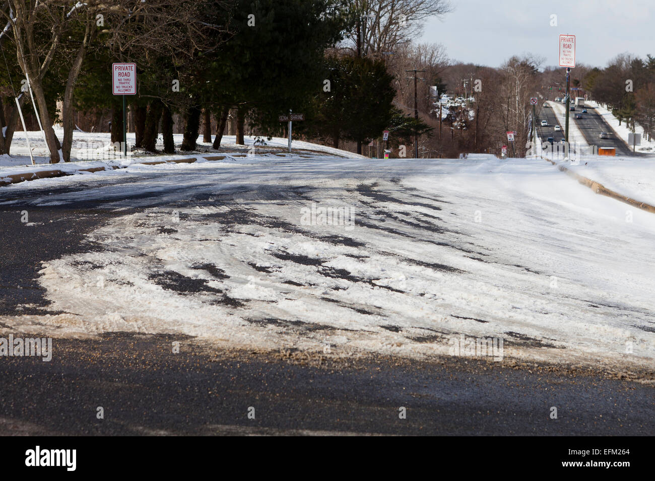 Snow covered roadway - USA - Stock Image