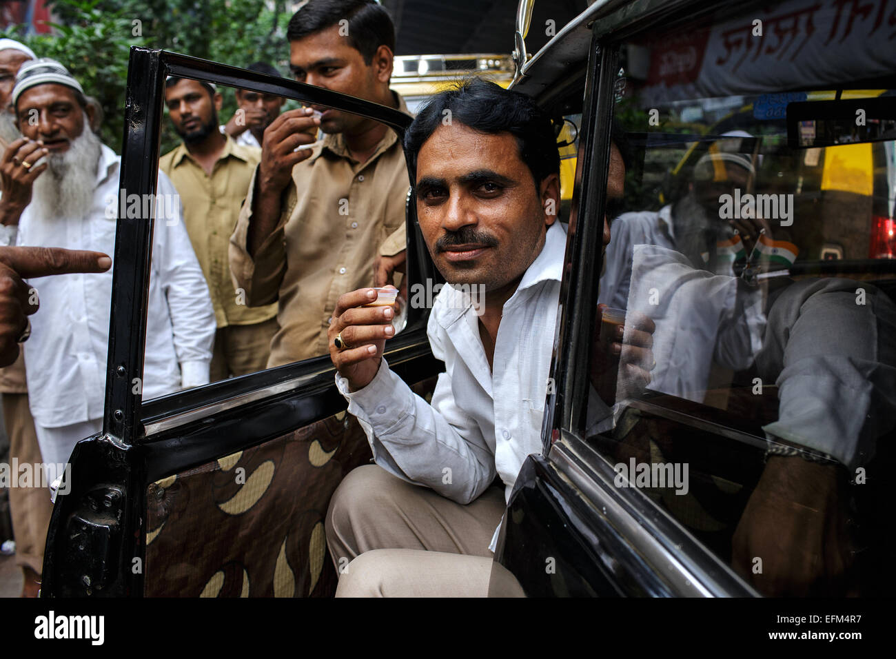 A taxi driver in his Premier Padmini car in Mumbai. Stock Photo