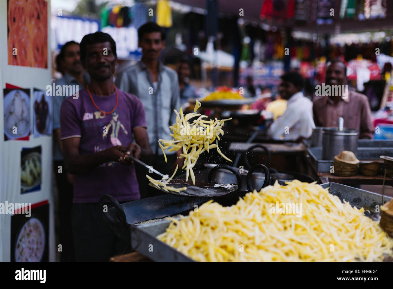 A local vendor prepares French Fries at Numaish,an industrial exhibition that is held annually in Hyderabad,India - Stock Image
