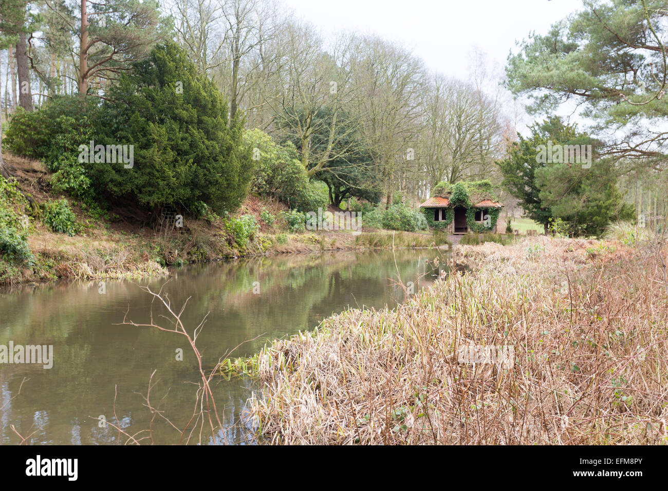 Lowther Castle's 'Jack Croft's pond', once used for ice and water, and a summerhouse, - Stock Image