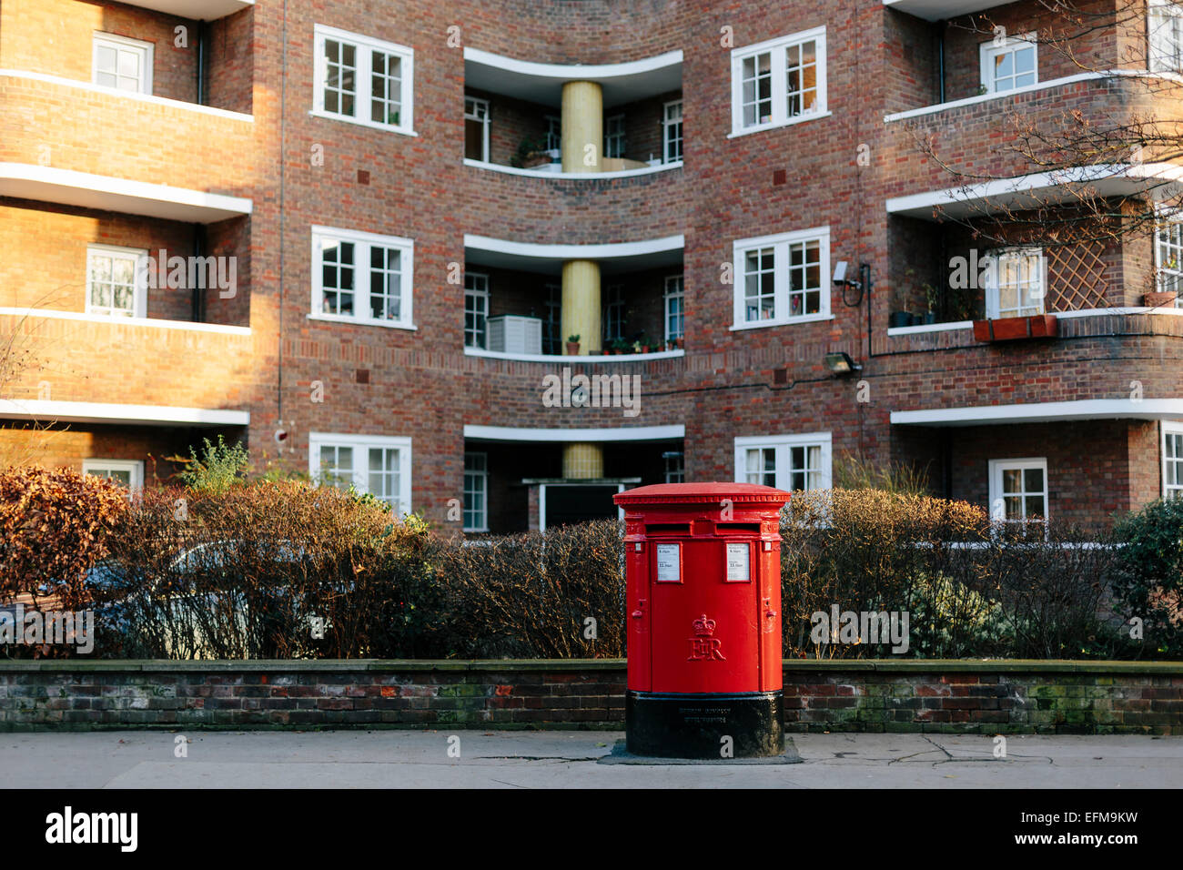 British Red Pillar Post Box in front of Flats in Belgravia London (Landscape format) Stock Photo