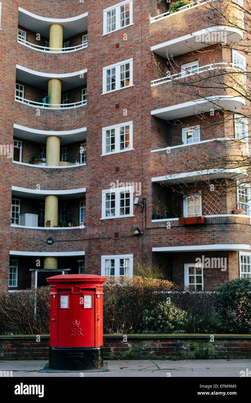 British Red Pillar Post Box in front of Flats in Belgravia London Stock Photo