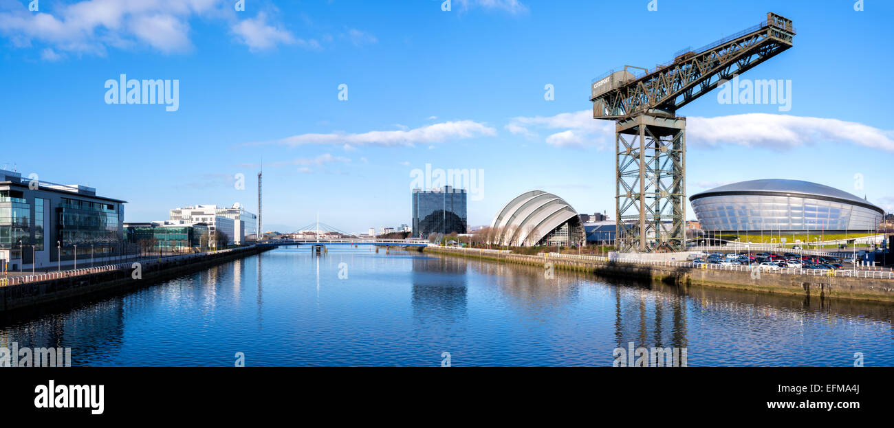 Panoramic of the River Clyde in Glasgow, looking west to the SECC (Armadillo), the SSE Hydro, the Finnieston Crane, the Bells, B Stock Photo