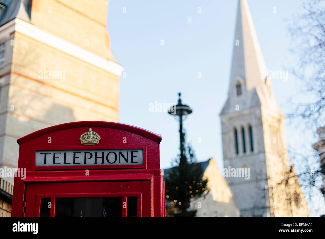 London Red Telephone Box with Church Steeple in background - Stock Image