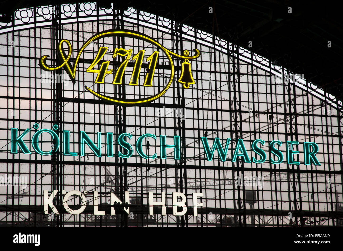 Advertisement for 4711 cologne set against end of Cologne main Railway Station - Stock Image