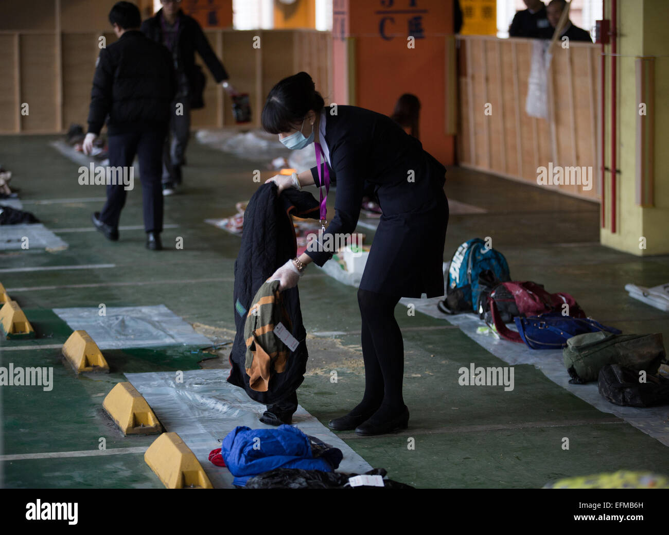 Taipei. 7th Feb, 2015. A staff member of TransAsia Airways sets the belongings of victims of the plane crash in - Stock Image