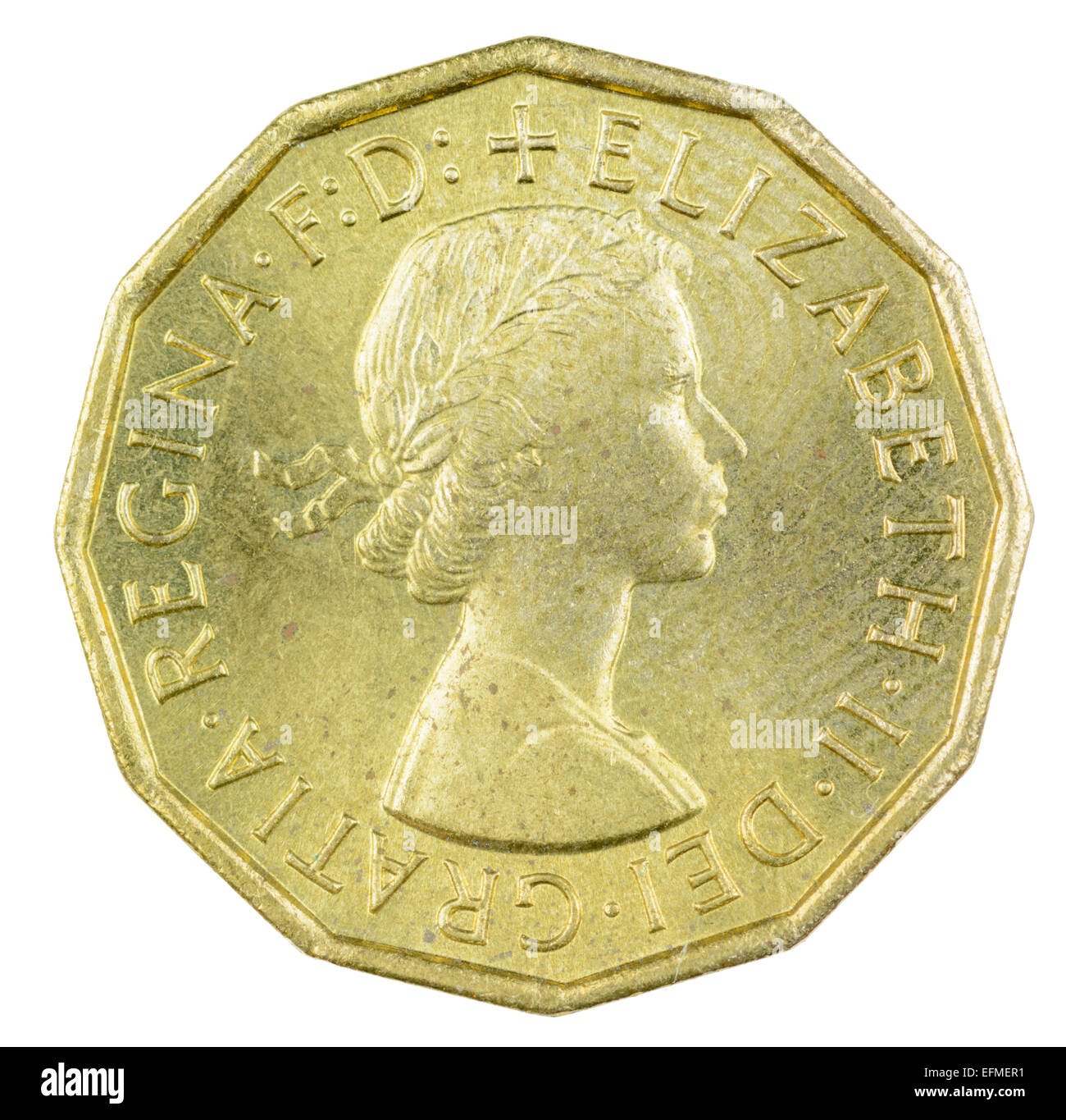 3d. Closeup of the head side of a gold coloured 1967 Threepenny piece coin on a white background. - Stock Image