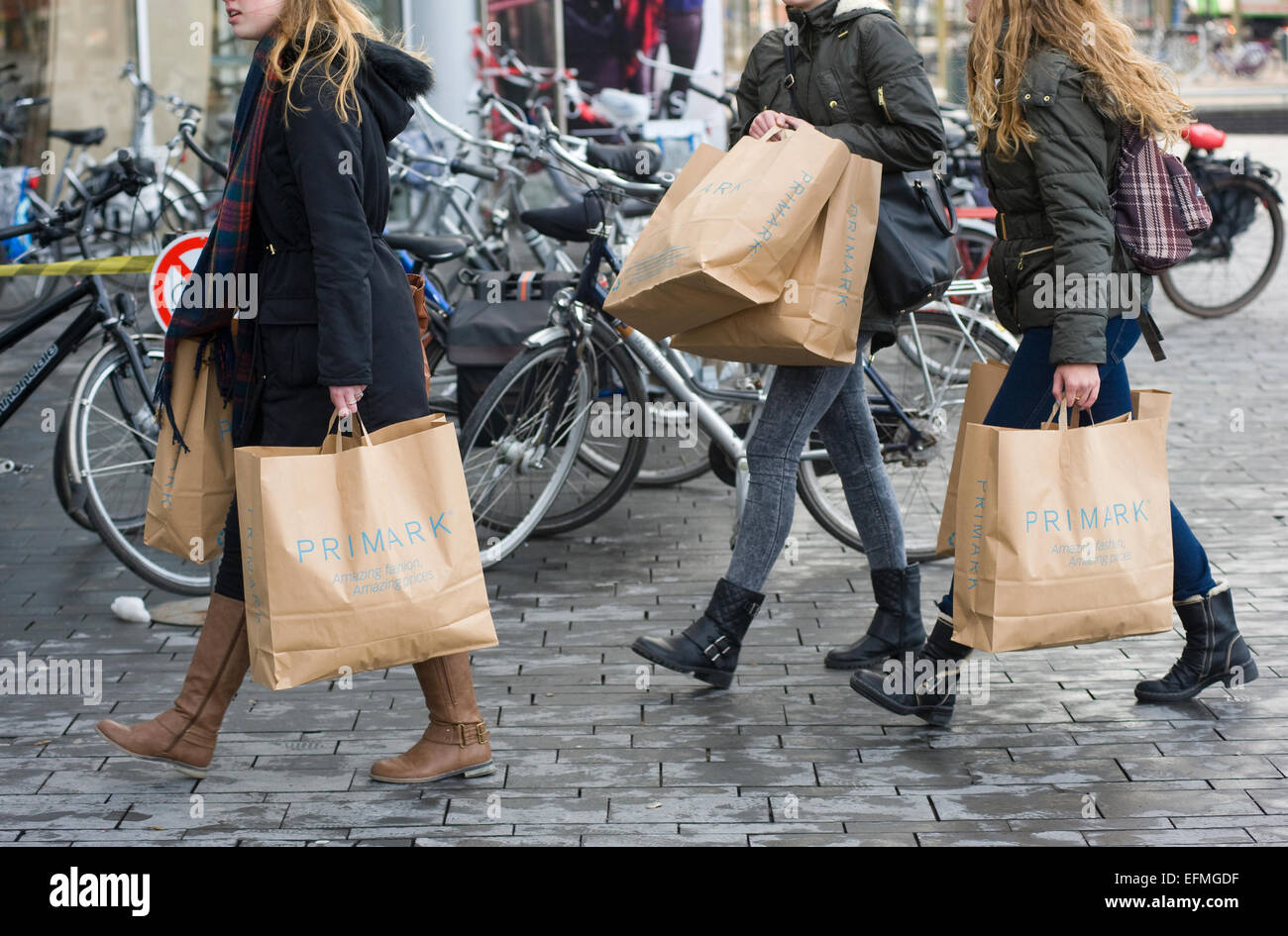 ENSCHEDE, THE NETHERLANDS - 05 FEB, 2015: Three women with shopping bags from Primark warehouse are walking on the - Stock Image
