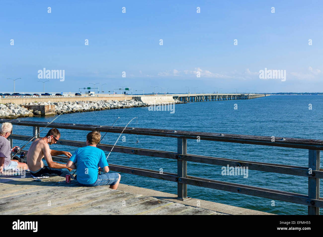 The fishing pier on Sea Gull Island, a part of the 23 mile long Chesapeake Bay Bridge-Tunnel, with a portion of - Stock Image