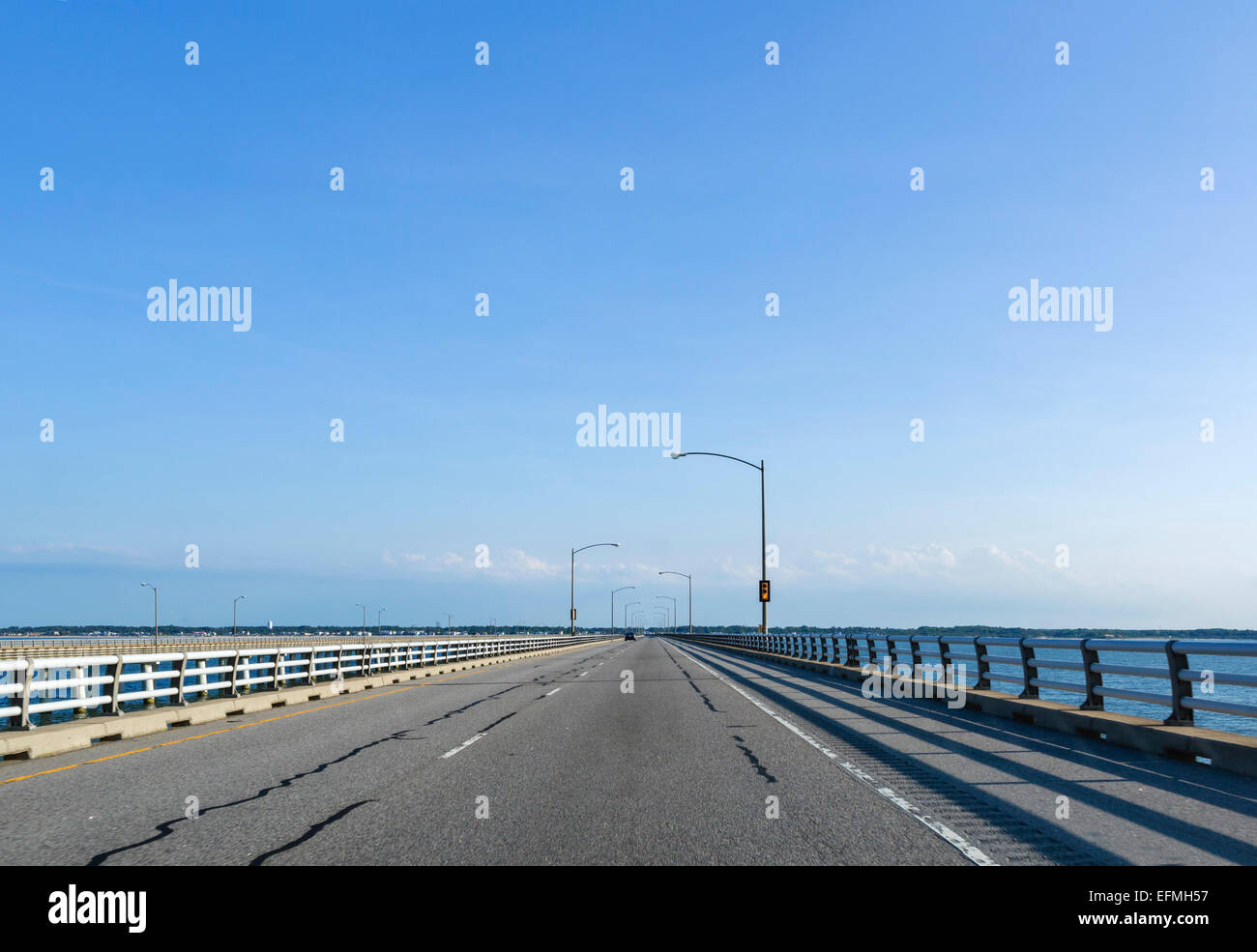 Driving across the 23 mile long Chesapeake Bay Bridge-Tunnel approaching the Virginia Beach end, Virginia, USA - Stock Image