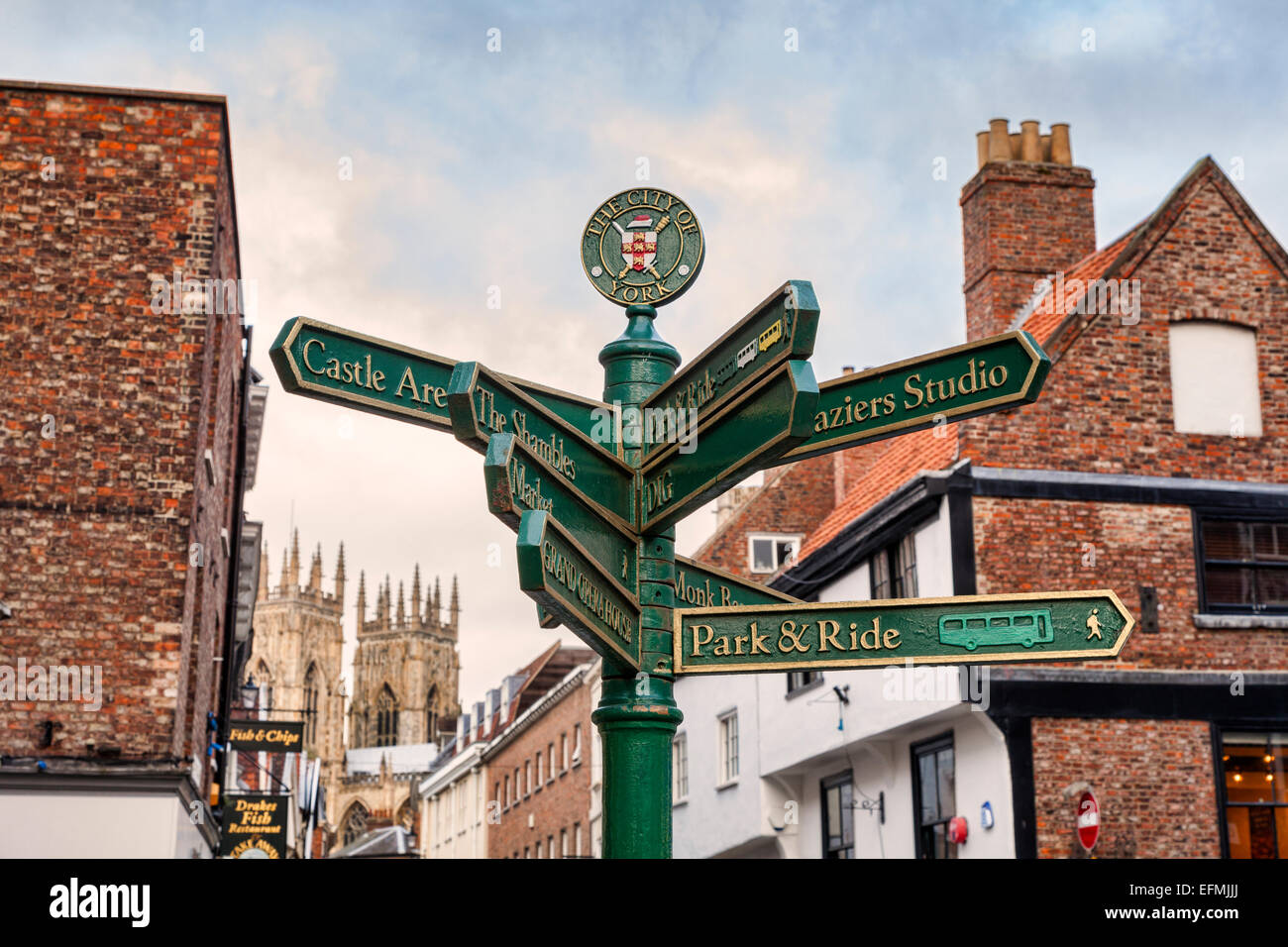 Signpost showing places of interest in Kings Square, York. Focus on sign. - Stock Image