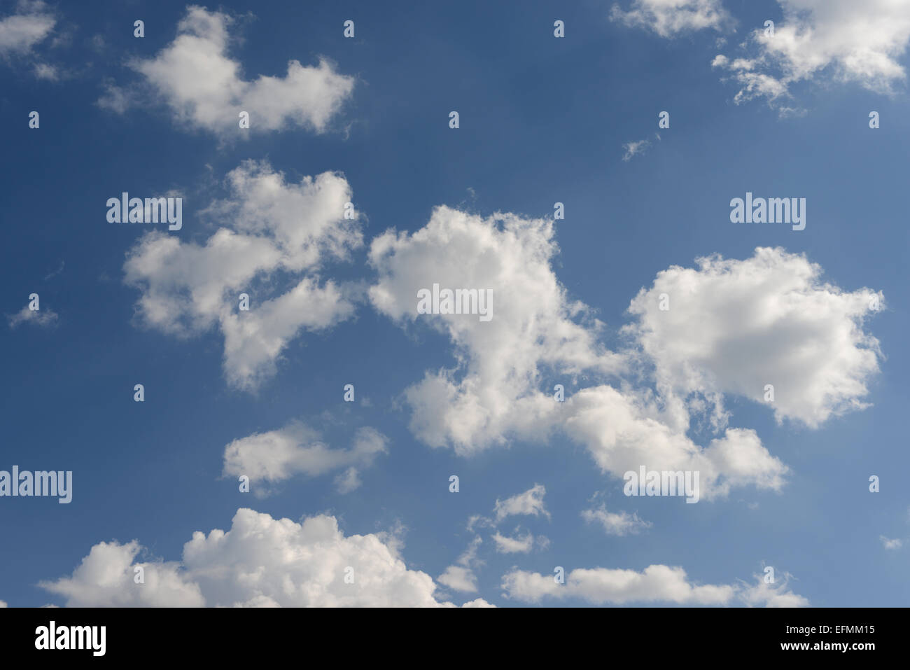 Beautiful cloudscape - fluffy white clouds in a sunny blue sky. - Stock Image
