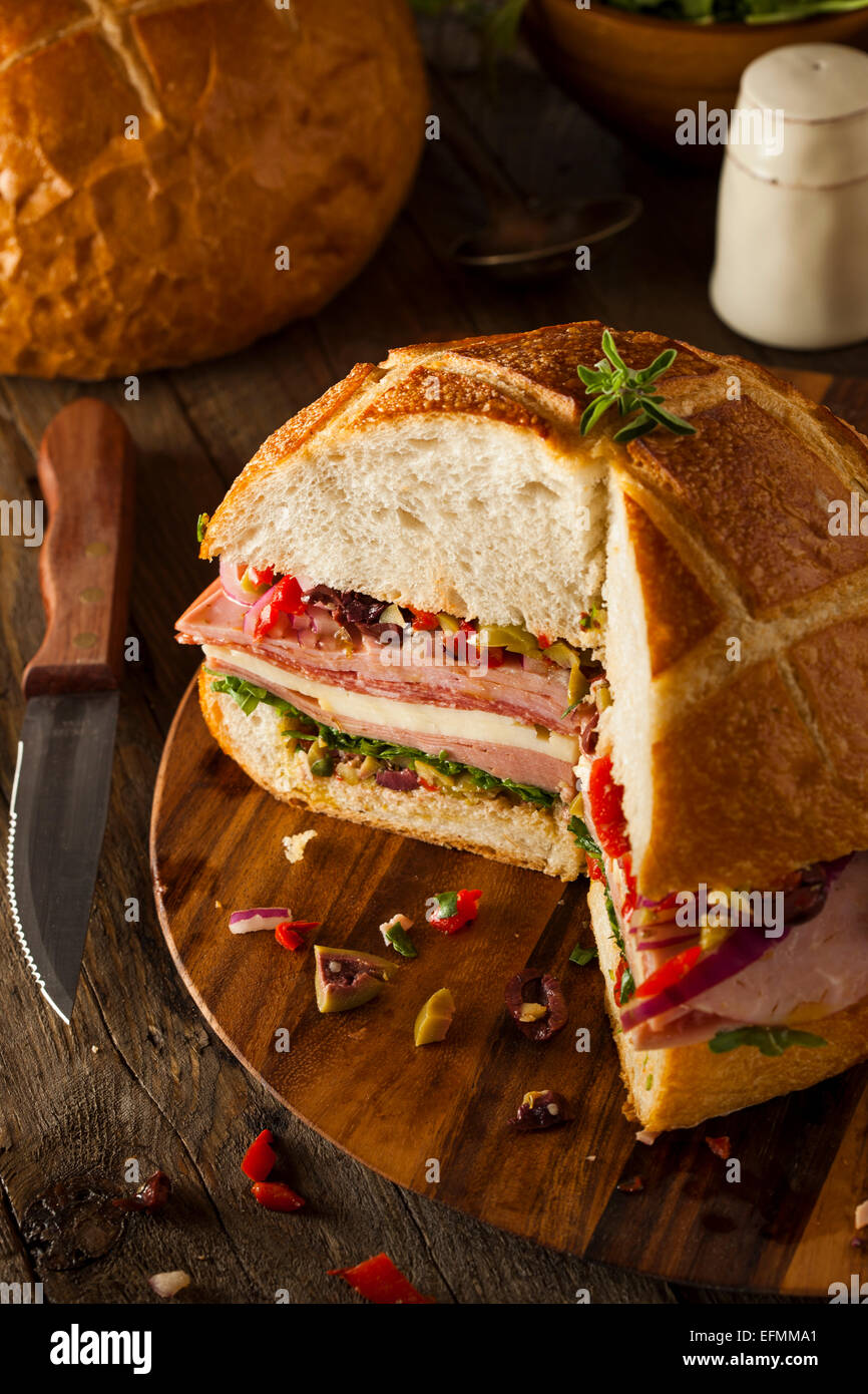 Cajun Muffaletta Sandwich with Meat Olives and Cheese - Stock Image