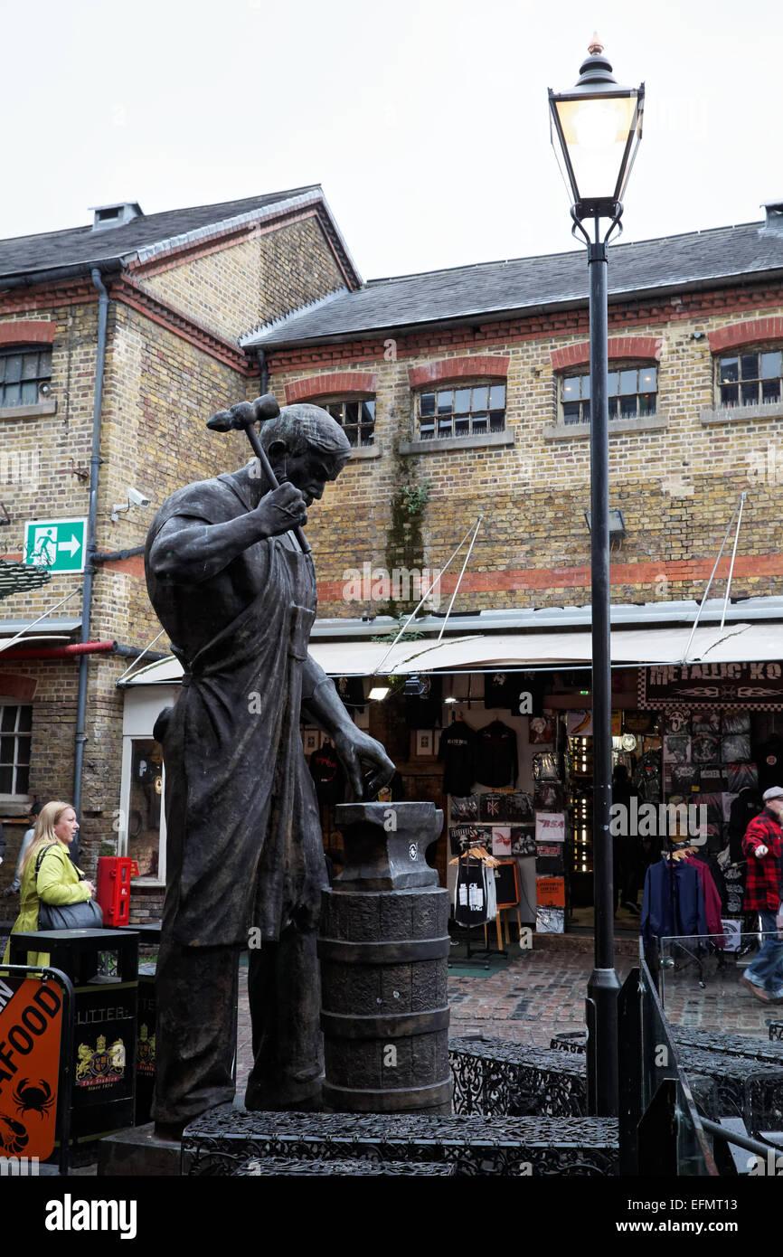 Bronze blacksmith statue, Camden Stables Market, London, UK - Stock Image