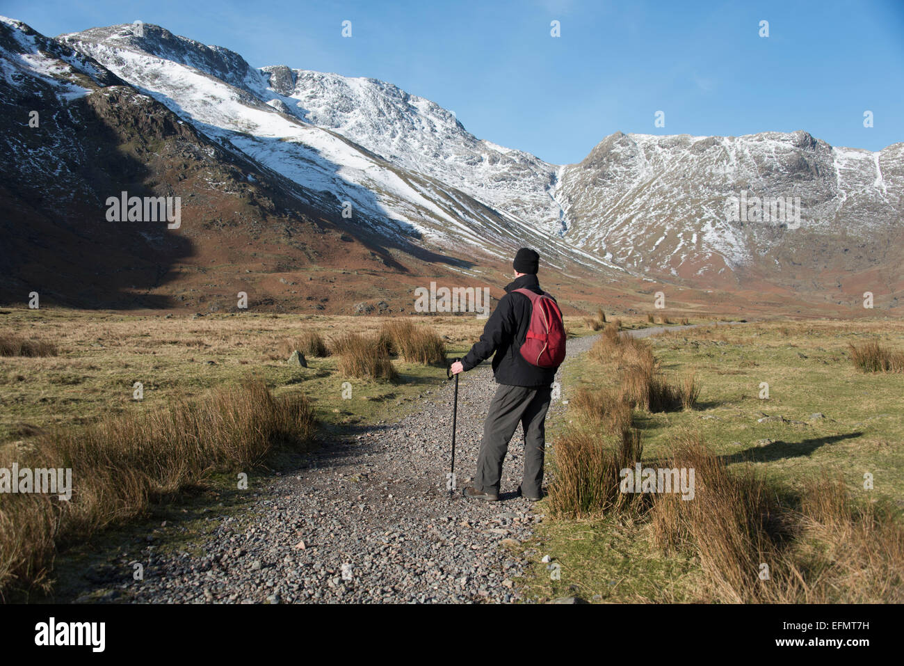 Start of the day in Upper Langdale Valley as fell walkers make their way out into the mountains.  English Lake District. - Stock Image