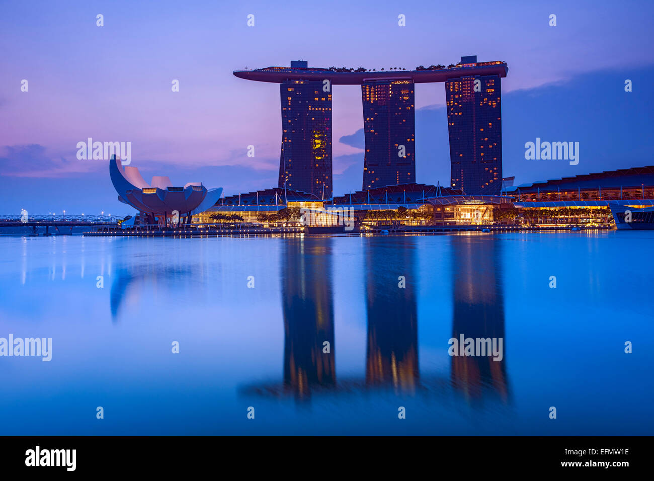 The Marina Bay Sands Hotel and the Art Science museum in Singapore at dawn. - Stock Image