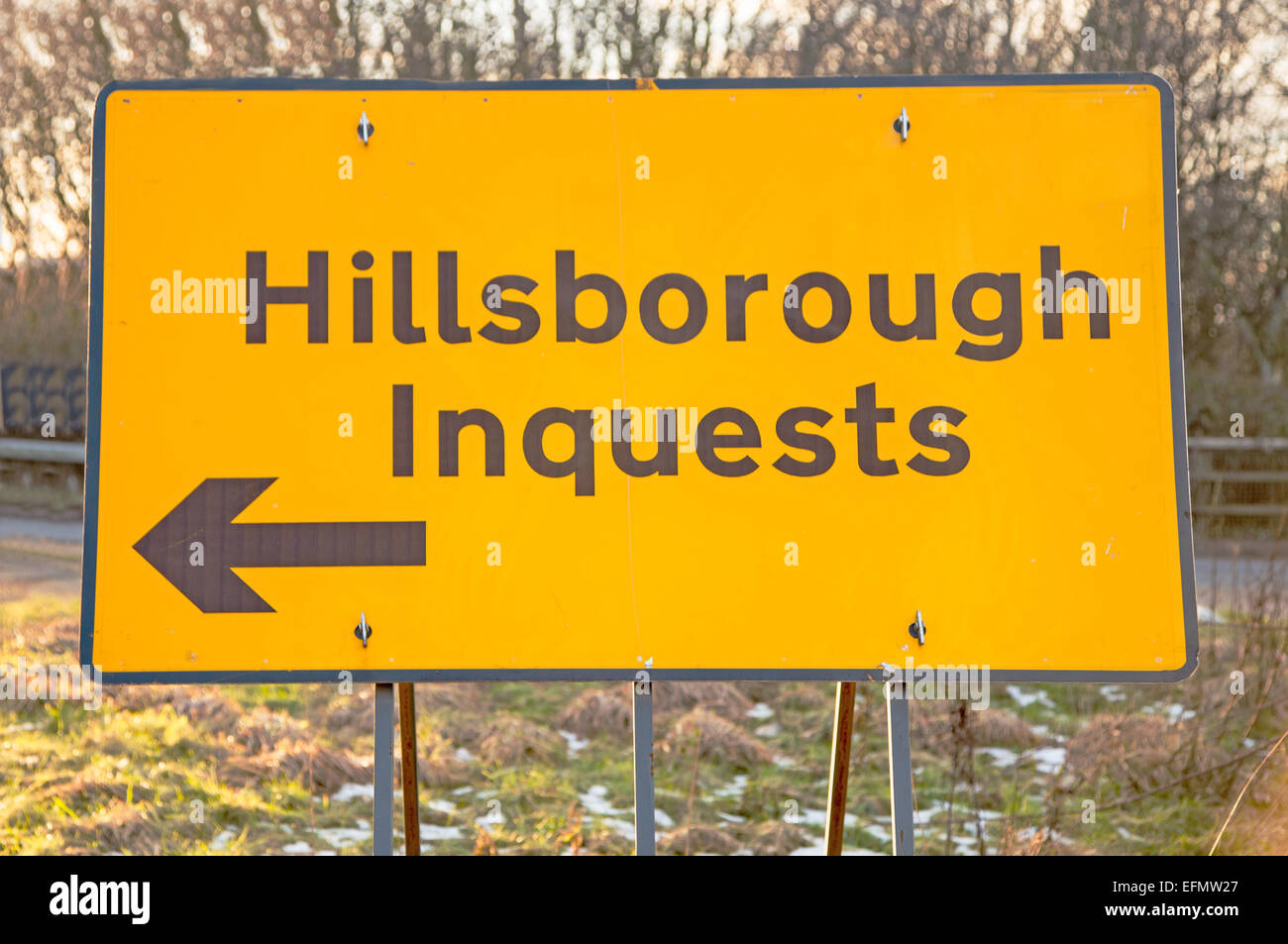 A road sign indicating the way to the Hillsborough disaster inquests near Wigan - Stock Image
