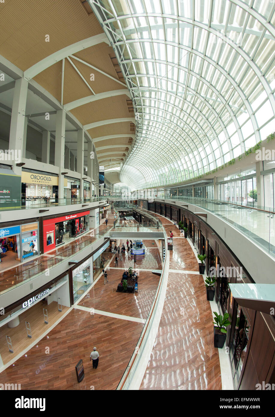 Interior of The Shoppes, a shopping mall attached to the Marina Bay Sands Hotel in Singapore. - Stock Image