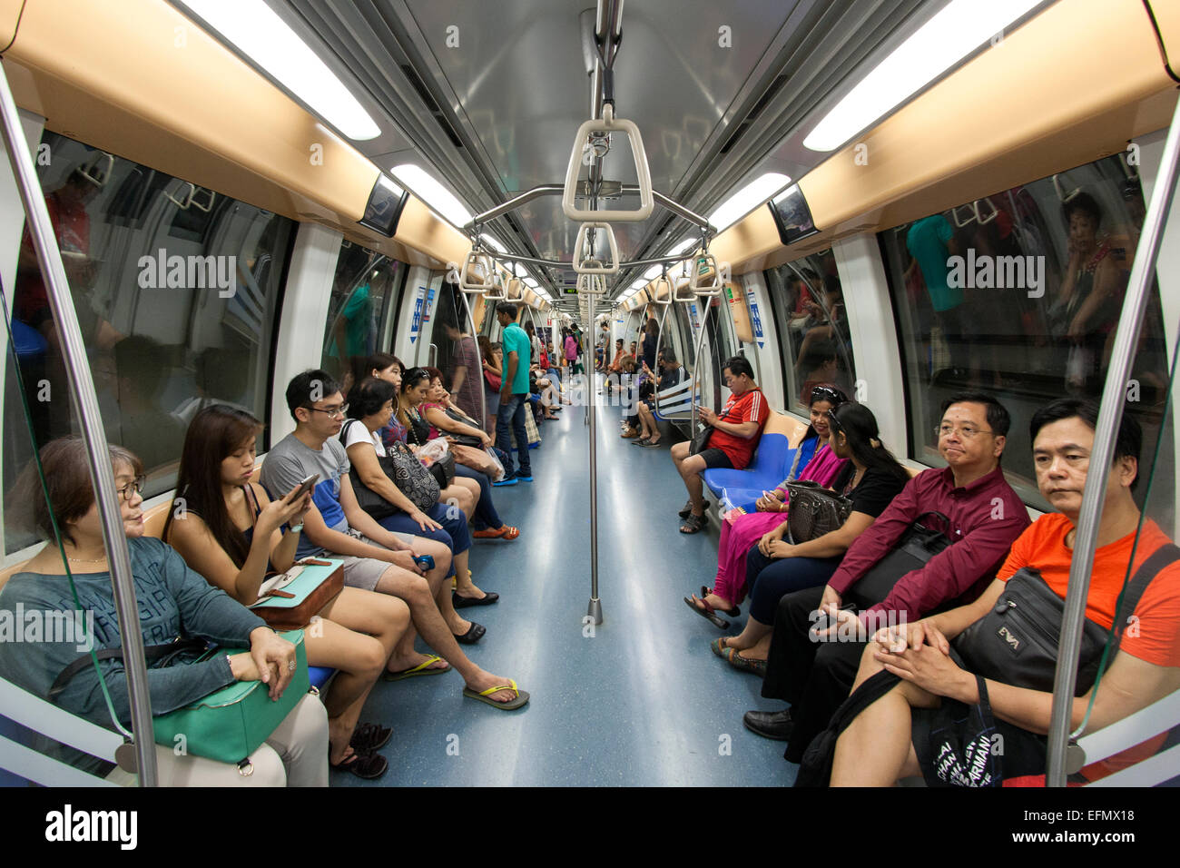 Interior of a carriage of the Singapore MRT (Mass Rapid Transit) system. Stock Photo