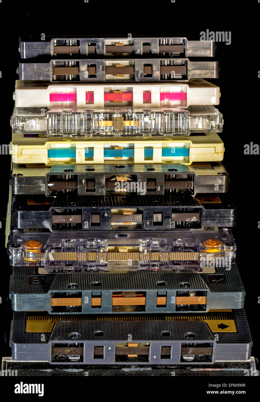 Stack of cassette tapes with ends exposed - Stock Image