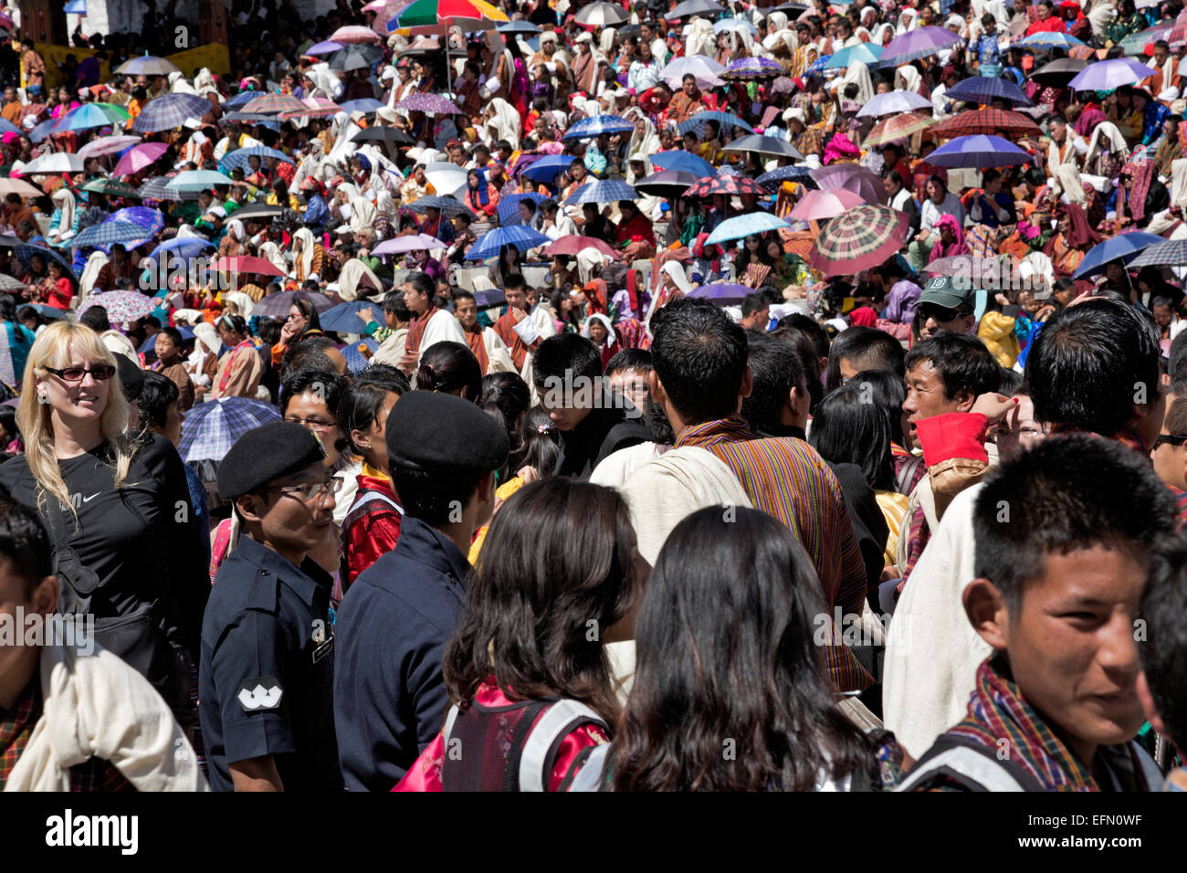 BHUTAN -Bhutanese in traditional clothing and tourists fill up the Trashi Chhoe Dzong for a day of ceremonial dancing Stock Photo