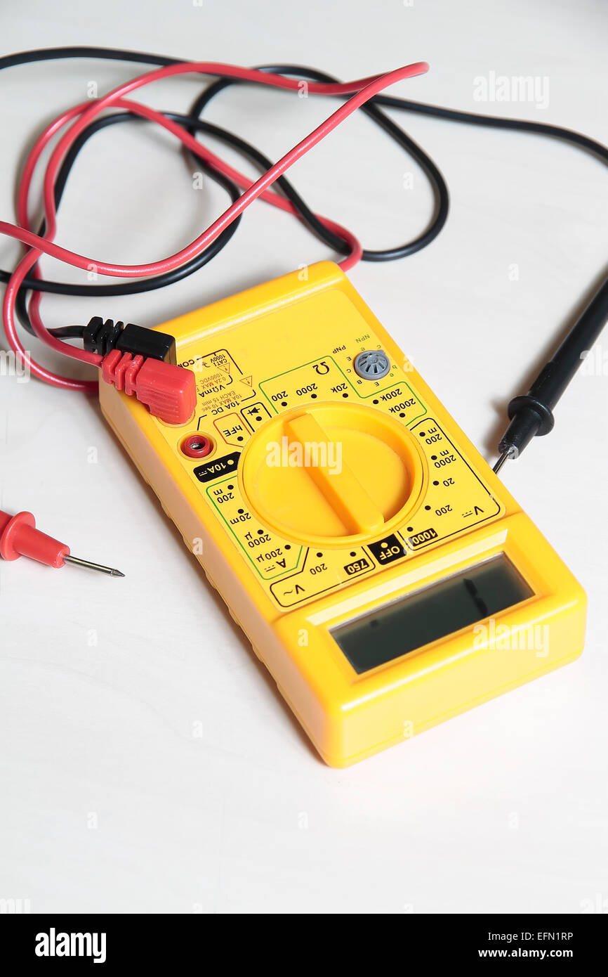 yellow multimeter tester to test electric equipment - Stock Image