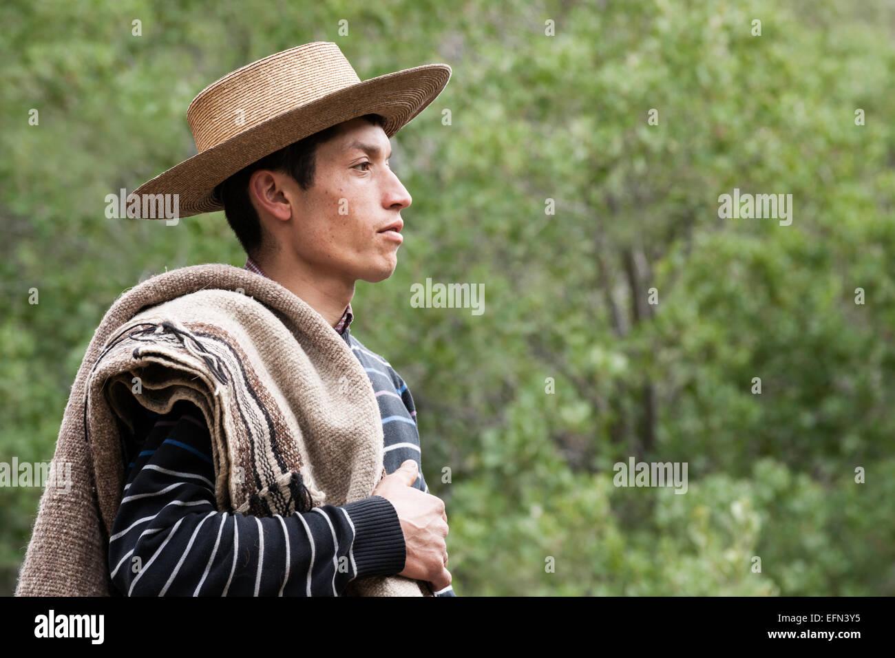 Portrait of Chilean cowboy in hat,  El Toyo region of Cajon del Maipo, Chile, South America - Stock Image