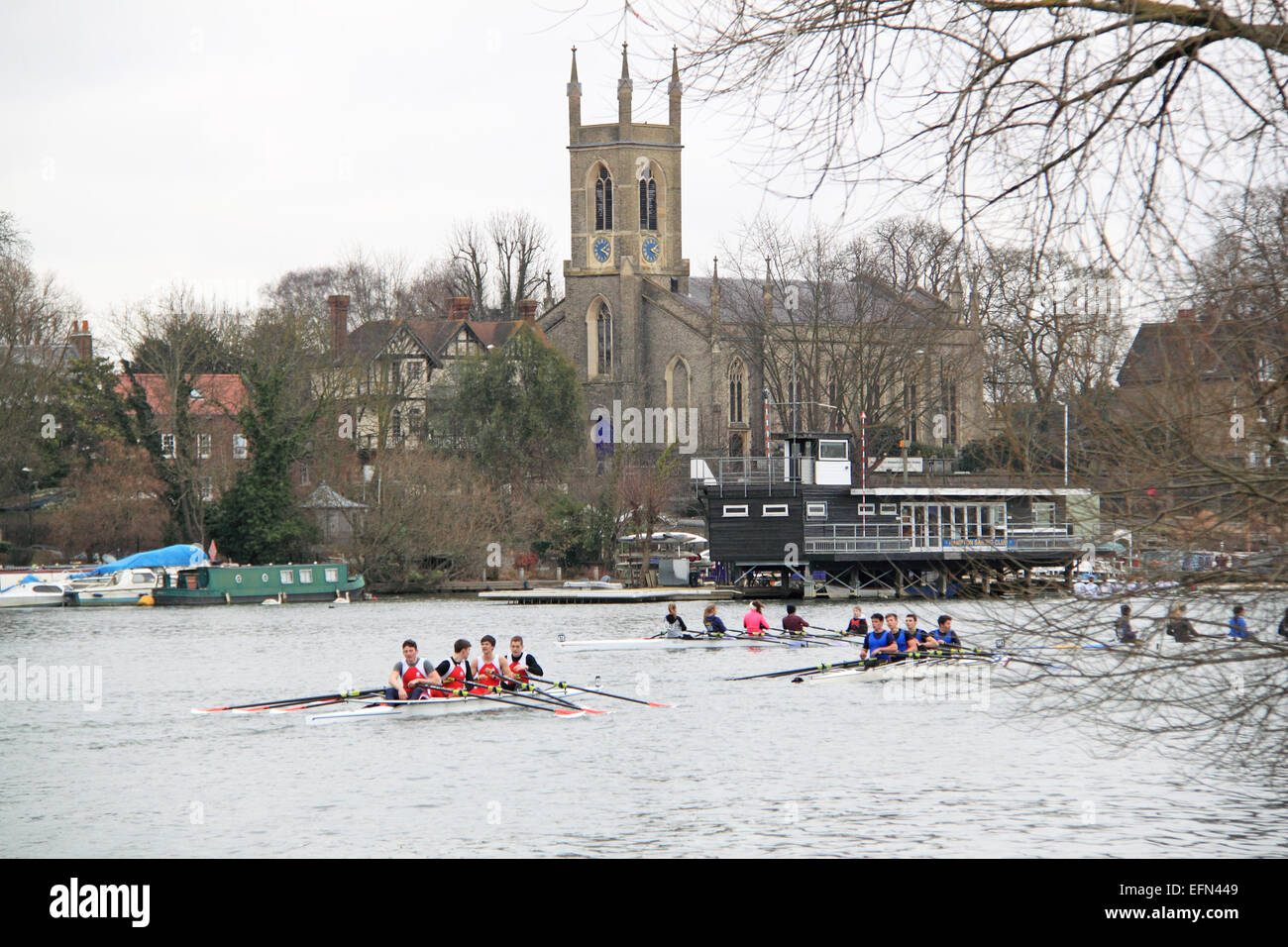 Radley College (nearest) and Tiffin School (blue) J18A.4x-. Hampton Head (Junior 4s and 8s) rowing event.  River - Stock Image