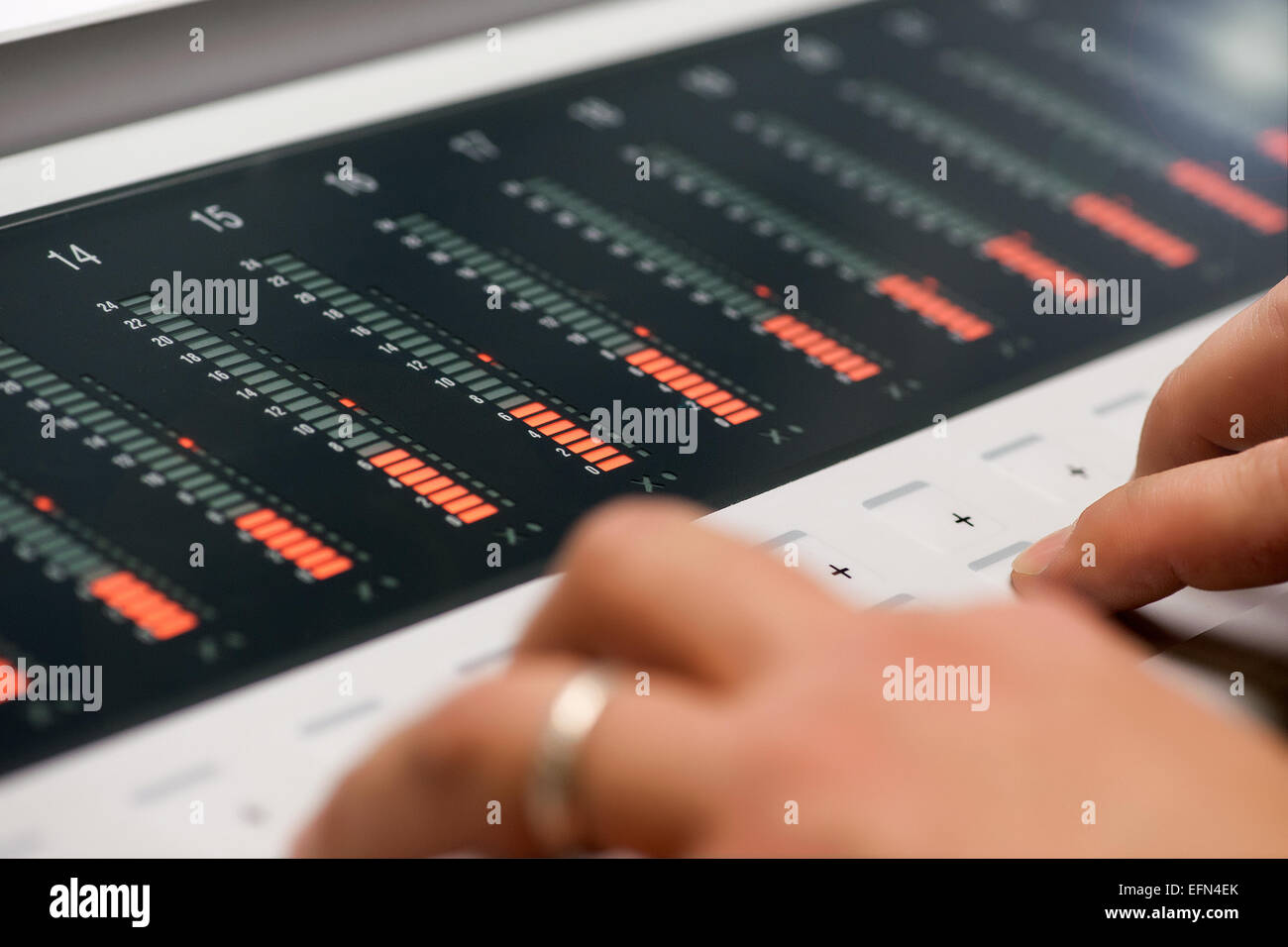 Close up Man Hand Operating a Modern Digital Printing Mixer Machine - Stock Image