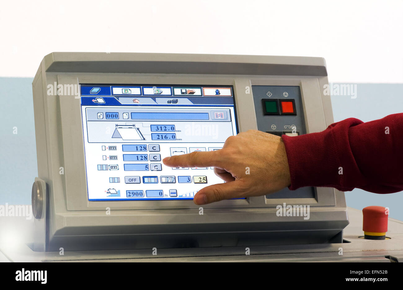 Close up Man Operating Touch Screen Device at the Table Inside the Office. - Stock Image