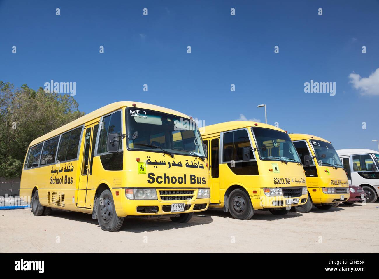 Yellow School Buses in the parking lot in Dubai. December 18, 2014 in Dubai, United Arab Emirates Stock Photo
