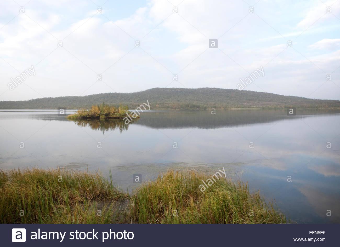 Calm lake Pousujärvi in Finnish Lapland - Stock Image