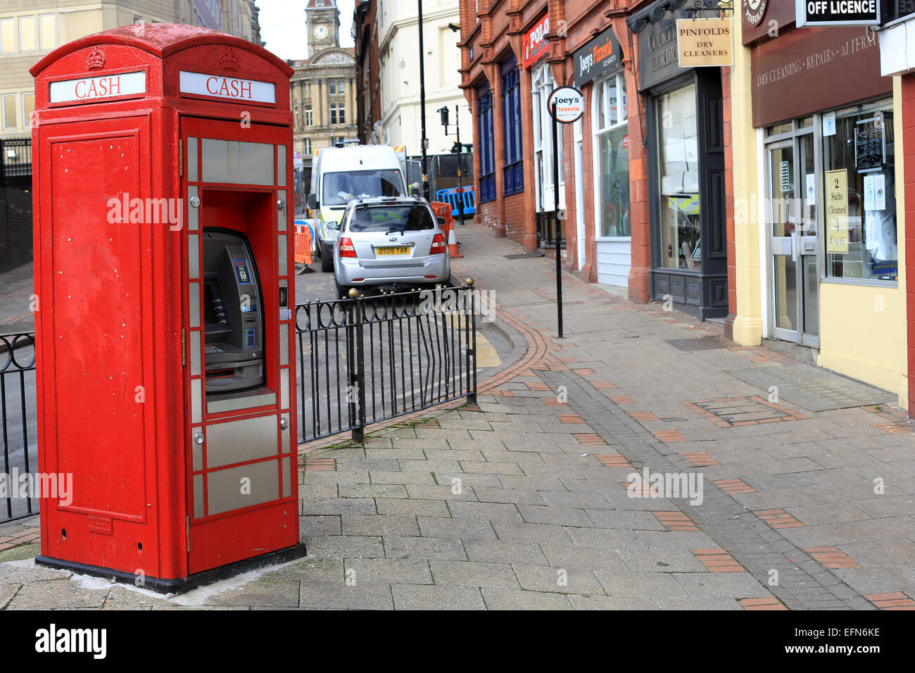 Cashpoint machine inside a red telephone box in Birmingham city centre. ATM cashpoint machine - Stock Image