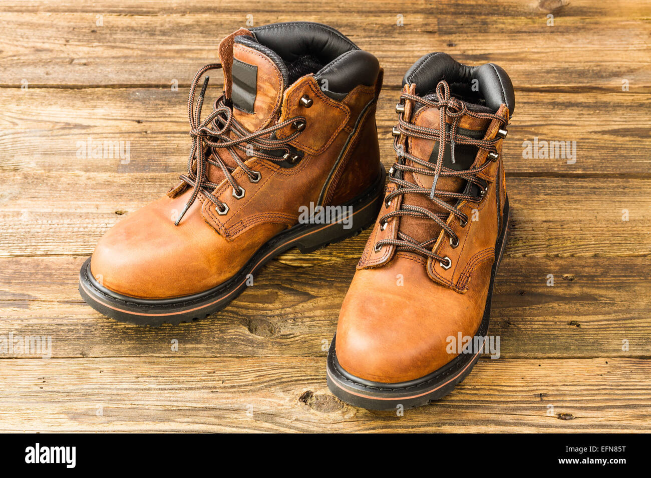 brown men's boots on wooden background Stock Photo: 78528740