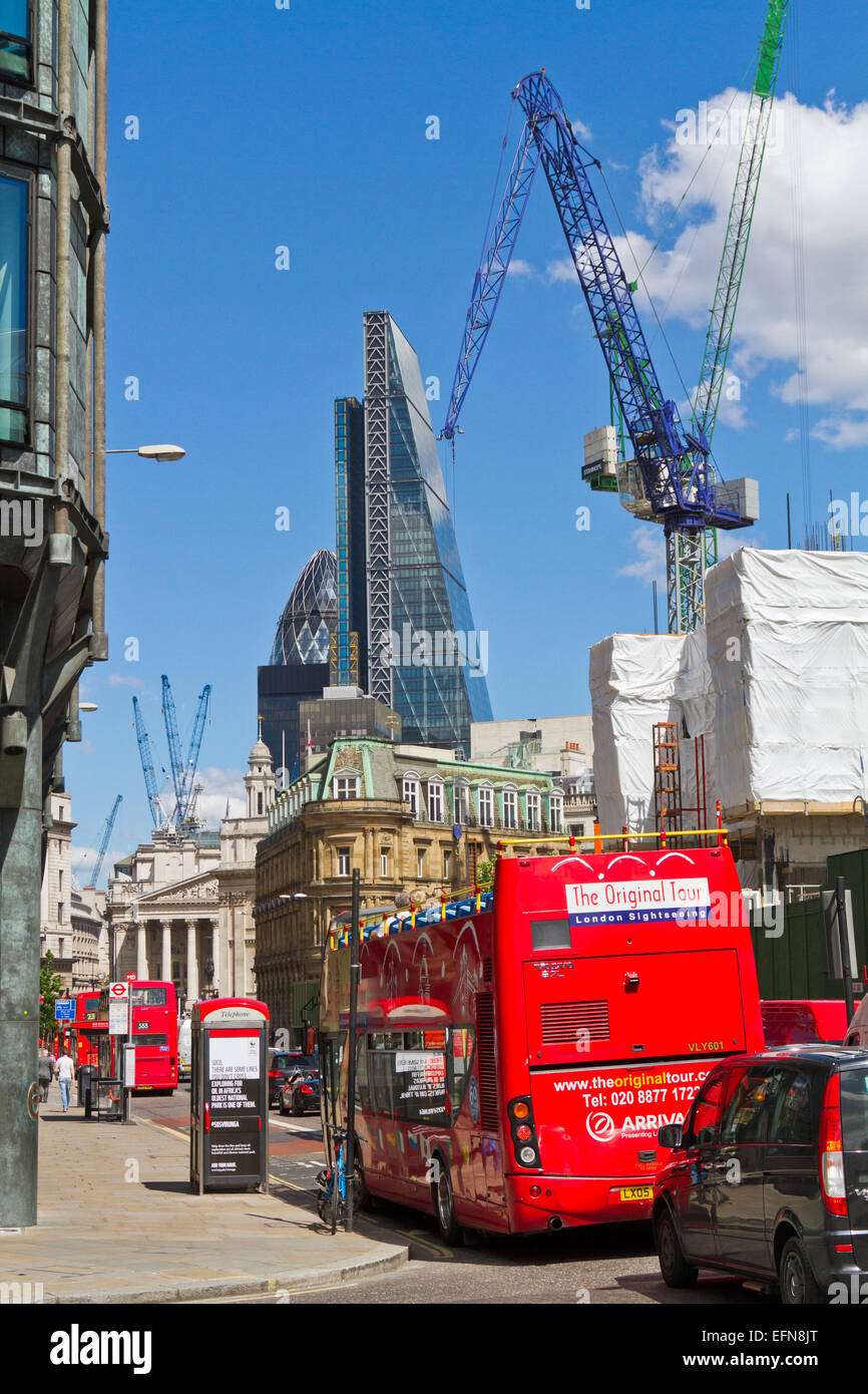 Traffic on Queen Victoria Street passes Bloomberg Place construction site in the City of London. - Stock Image